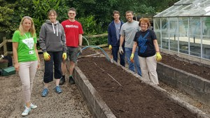 Corporate Volunteers helping with gardening
