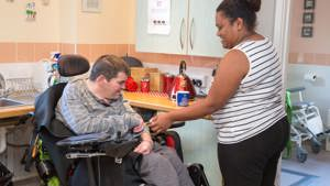 Client with carer in the kitchen