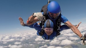 Skydiver mid-jump for Enham Trust
