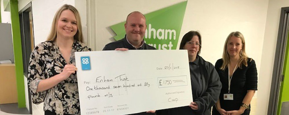 Coop presenting cheque to Enham Trust staff