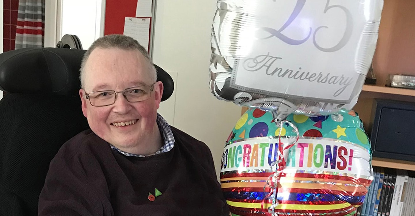 Jonathan celebrating 25 years living at Enham Trust