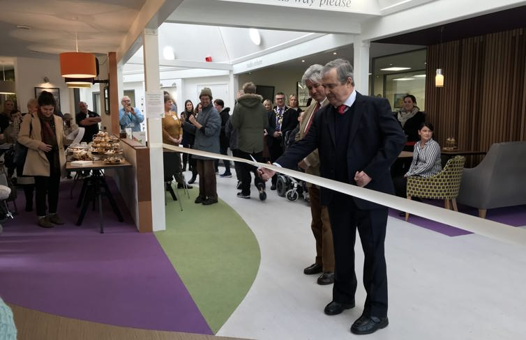 Sir Freddie Viggers cutting the opening ribbon at the Enham Trust Cafe