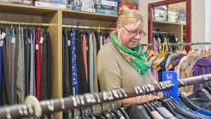 Customer browsing shelves at the Enham Trust Charity Shop