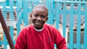Boy smiling using The Move Programme